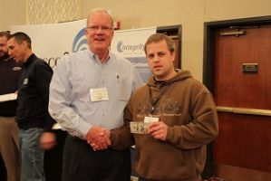 Meter Change Out winner Brent Harr, Stutsman Rural Water with Bo Image